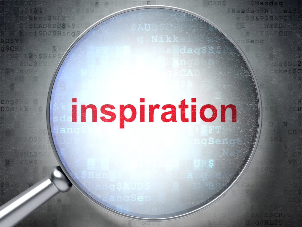Magnifying glass with the word inspiration